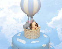 Up, Up and Away! - The cloud cutters from our Country Silhouette Set and Basketweave embosser has been used on this adventurous cake.